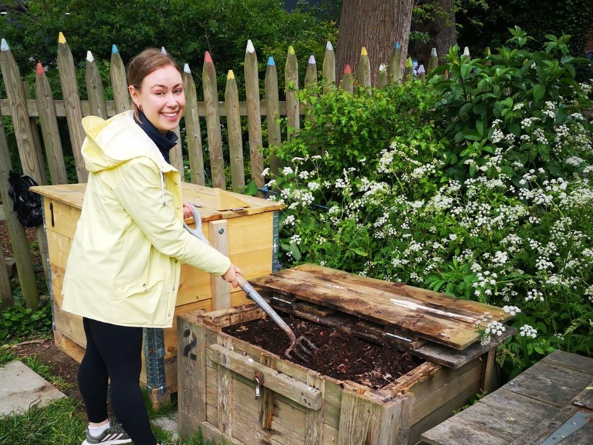 Volunteer Cornelia turning compost at a community compost site, image credit Brighton & Hove Food Partnership