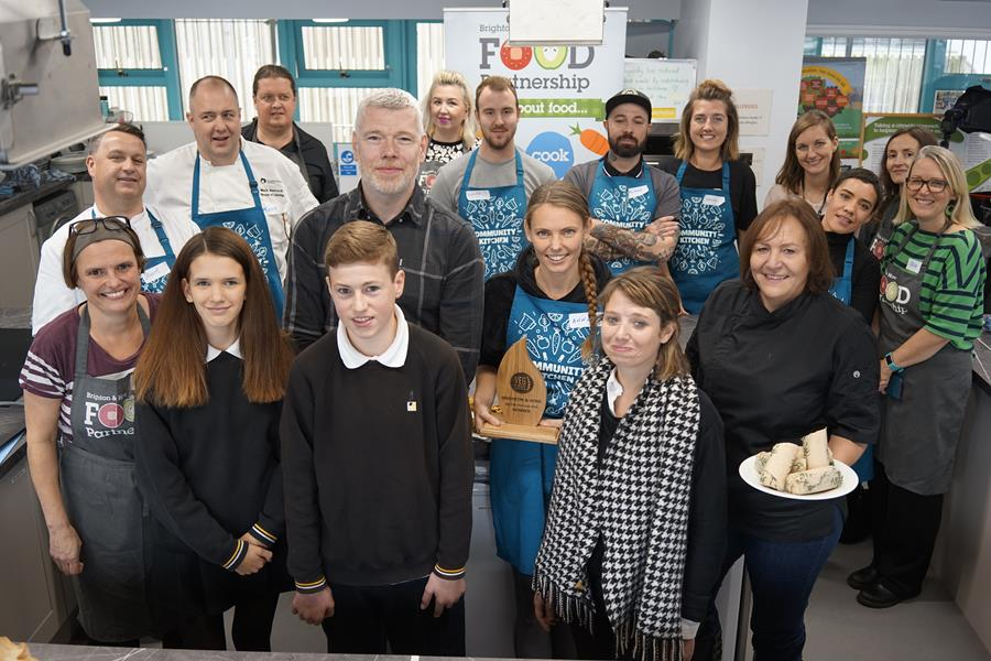 Winner Anna MacDonald from Happy Maki with the judges Michael Bremner, Nicole Pisani, Julie Barker and pupils Millie and Spike (from Dorothy Stringer Secondary School), chefs and competition organisers at the Community Kitchen. Credit: XDB photography
