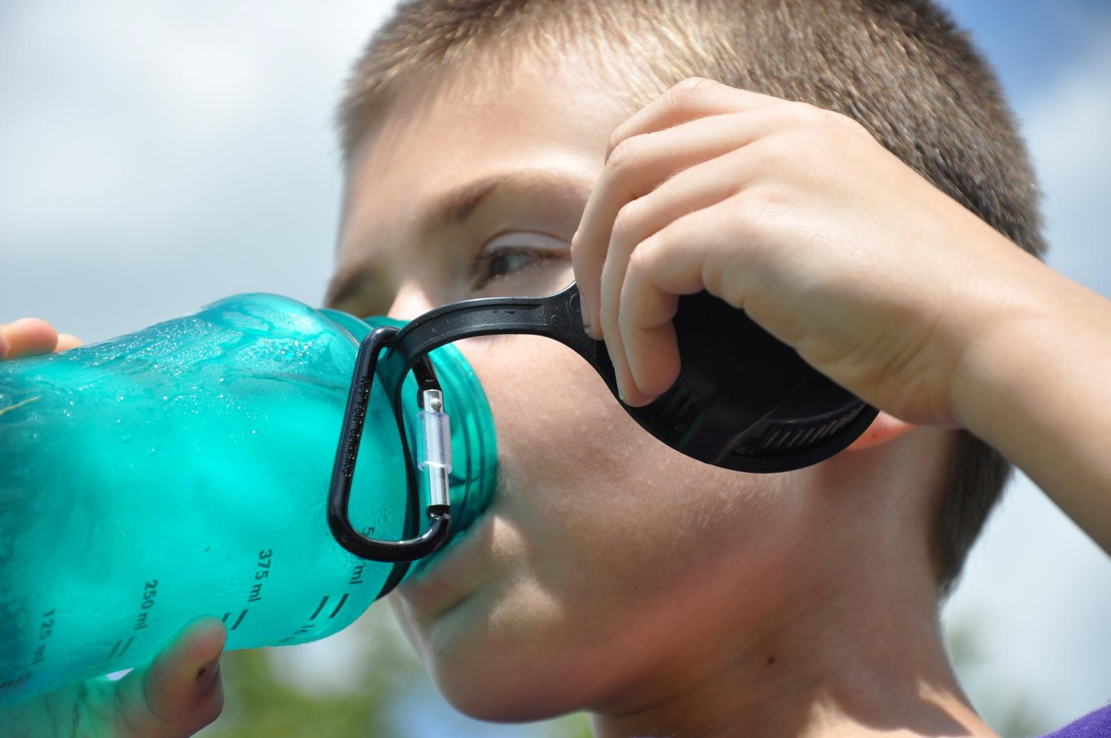 Boy drinking from a reusable bottle. Photo credit: Pixabay