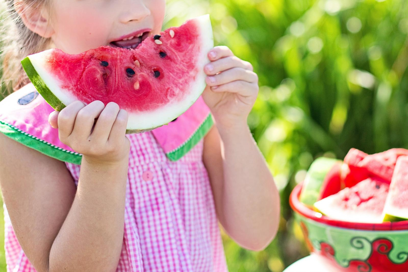 Child eating a watermelon. Photo credit: Pexels